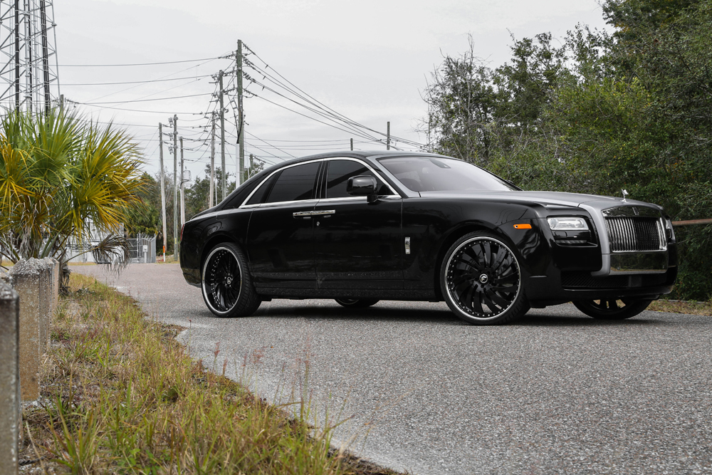 rolls royce ghost black 2015. this one sitting on a set of canale in black center chrome lip put together by nb customs tampa florida rolls royce ghost 2015